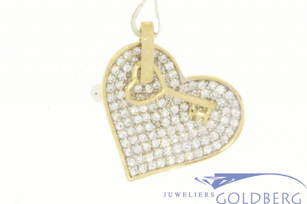 Vintage 14 carat gold heart pendant with zirconia and a little key
