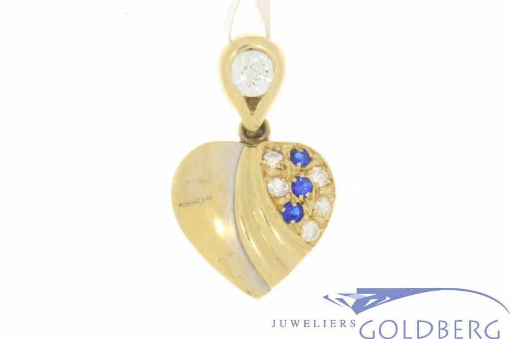 Vintage 14 carat gold heart pendant with white and blue zirconia