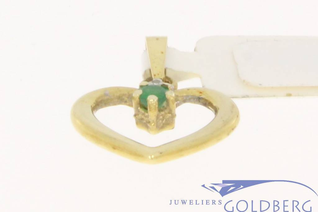 Vintage 14 carat gold heart pendant with emerald and diamond