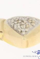 Vintage 14 carat gold heart pendant with ca. 0.054ct diamond