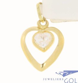 Vintage 18 carat gold pendant with open heart and a heart shaped zirconia