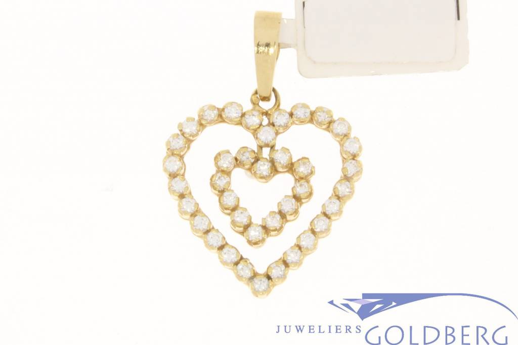 Vintage 18 carat gold pendant with two hearts embedded with zirconia