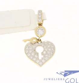 Vintage 14 carat gold  heart-shaped pendant with key and zirconia