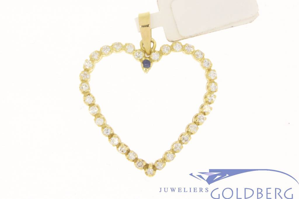 vintage 18k gold pendant as a heart with diamonds