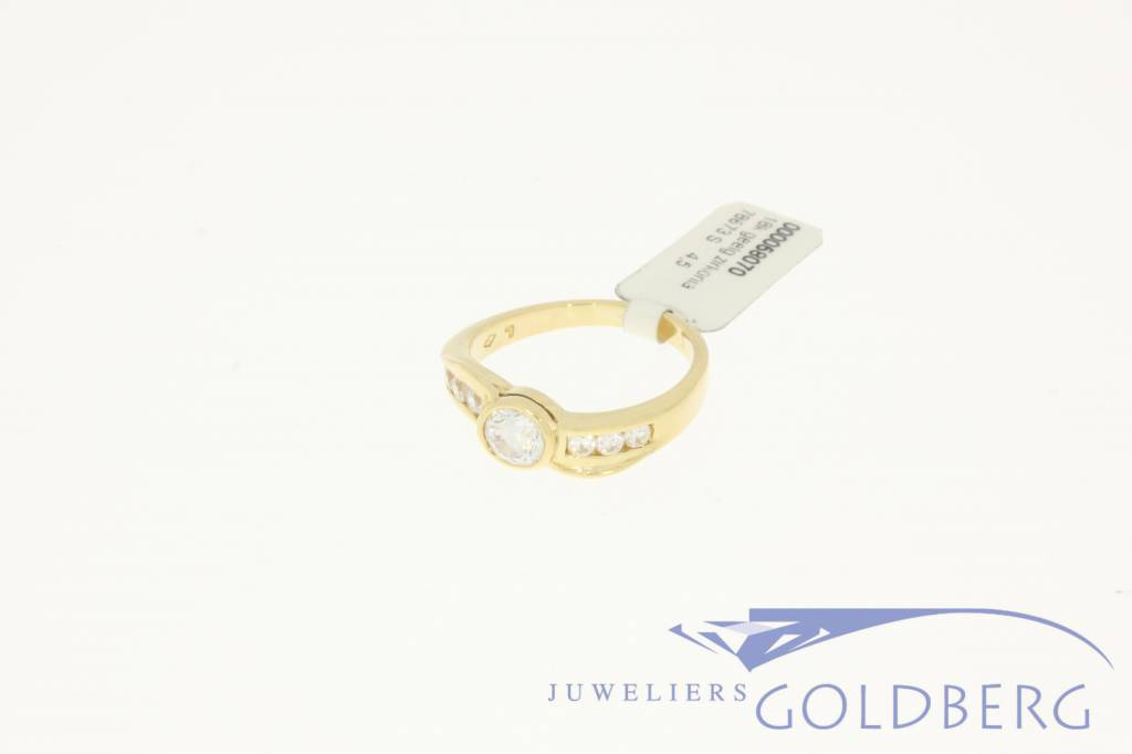 Vintage 18k gold wave shaped ring with 7 zirconia's