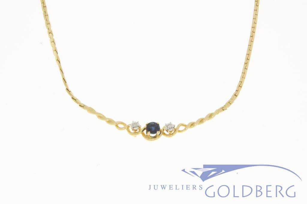 Vintage 18 carat golden necklace with diamonds and blue sapphire