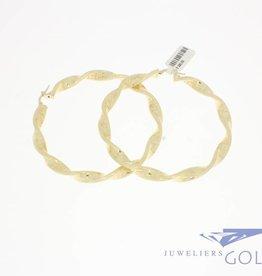 Vintage 18k gold Versace creole earrings