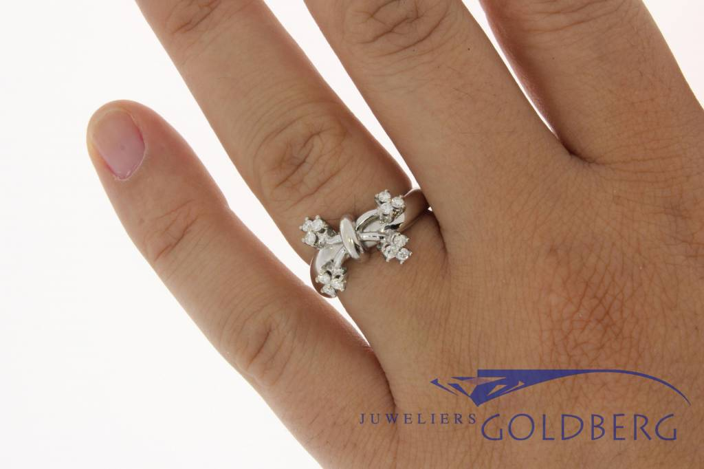 18 carat white gold vintage ring with bow motif and ca. 0.25c brilliant cut diamond