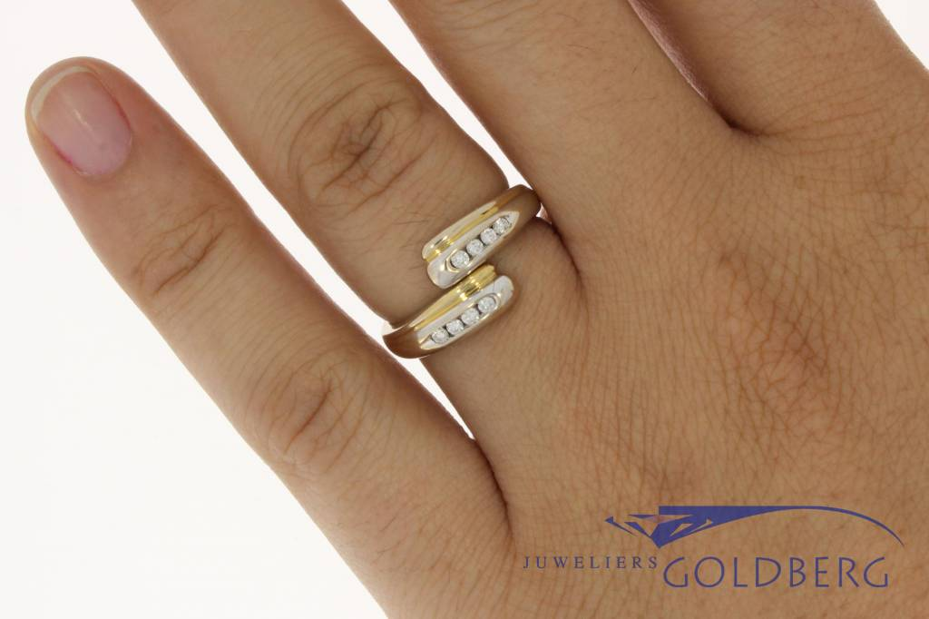 Elegant 18 carat bicolor gold vintage ring with approx. 0.15 carat brilliant cut diamond rail setting