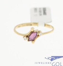 Lovely and delicate 14 carat gold vintage ring with ruby and zirconia