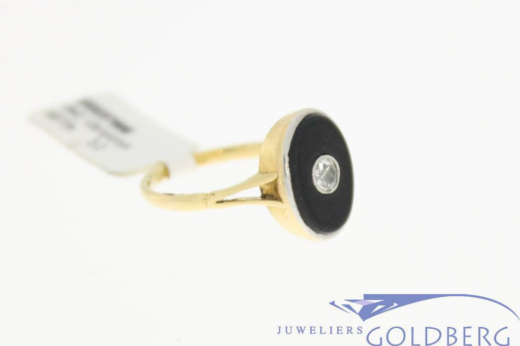 Antique 18 carat gold and platina mourning ring with onyx and ca. 0.10 carat old cut diamond