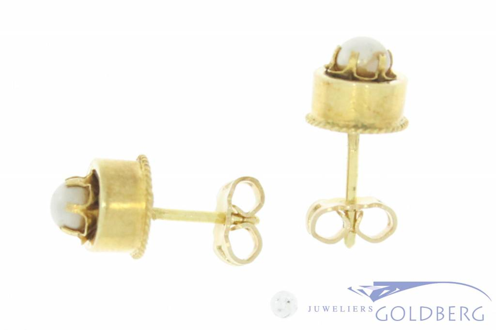 Antique 14 carat gold ear studs with pearl