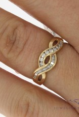 Vintage 14 carat gold  ring with ca. 0.25ct brilliant and baguette cut diamond
