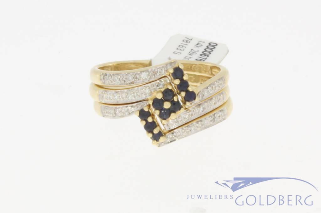 Vintage 14 carat gold three-piece ring set with blue sapphire and brilliant cut diamond