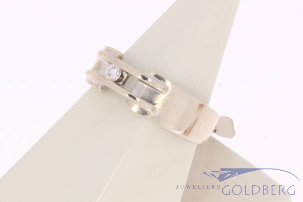 Vintage 14 carat white gold design ring with 0.08ct brilliant cut diamond