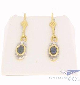 Vintage 18k bicolor gouden oorhangers met blauwe saffier