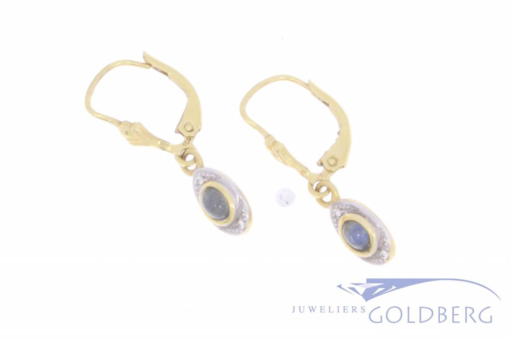 Vintage 18 carat bicolor gold earrings with blue sapphire