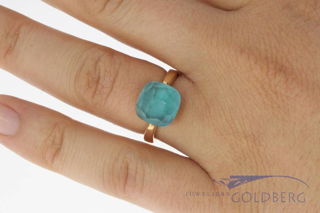 18 carat rose gold ring with facet cut blue stone