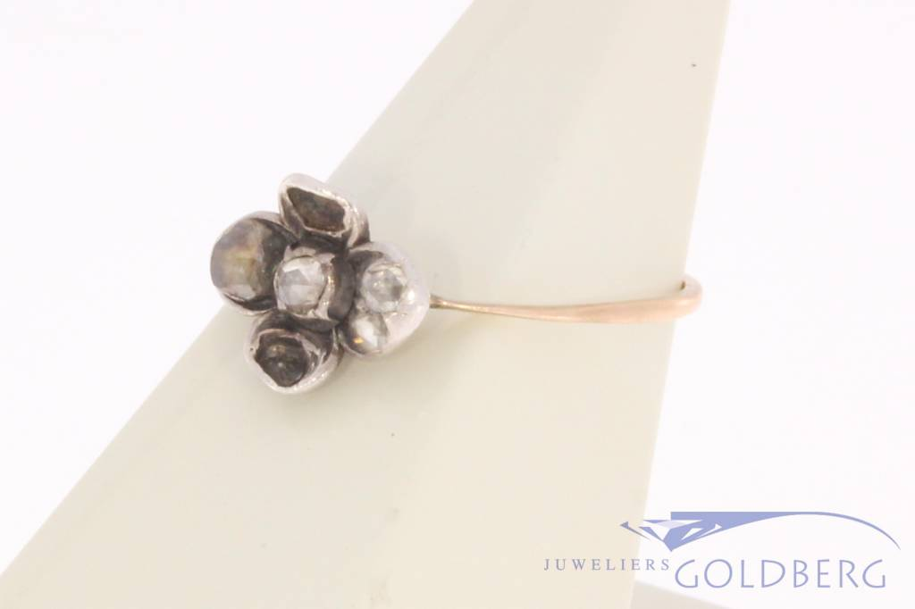 Antique 14 carat gold and silver flower-shaped ring with diamond