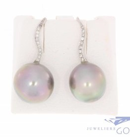 Vintage 18 carat white gold earrings with 0.20ct brilliant cut diamond and black Tahiti pearl