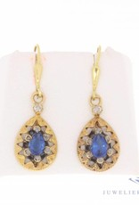 Vintage 14 carat gold vintage earrings with diamond and synthetic sapphire
