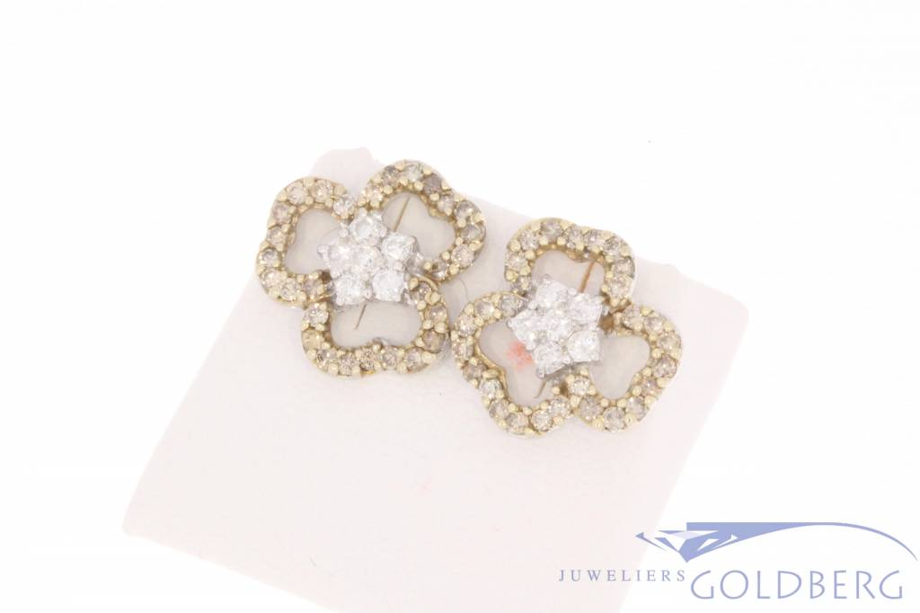 Vintage 18 carat white gold, flower/clover shaped ear studs with 1.17ct diamond