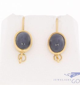 Vintage 18 carat gold earrings with star sapphire