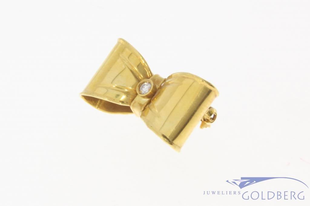 Vintage 18 carat gold bow brooch with ca. 0.035ct brilliant cut diamond