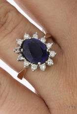 14 carat gold rosette ring with ca. 0.48ct brilliant cut diamond and sapphire