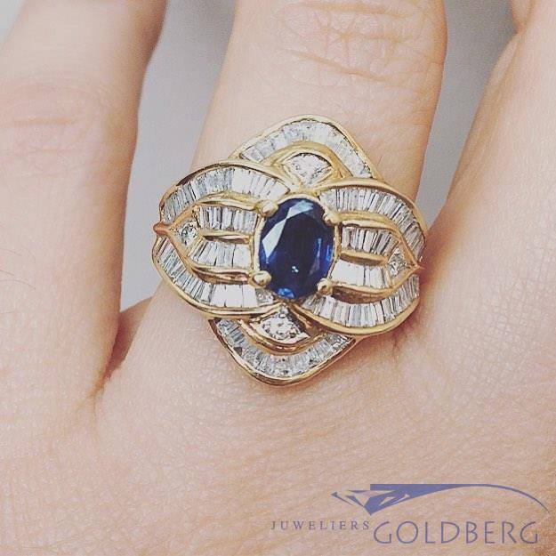 18 carat gold ring with baguette cut diamond and blue sapphire
