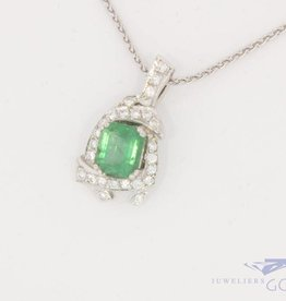 18 carat white gold pendant with emerald and ca. 0.25ct brilliant cut diamond