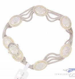 Vintage zilveren armband met versierde ovaaltjes