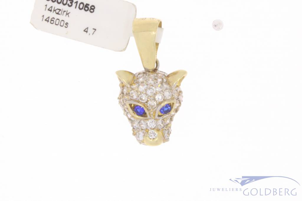 Vintage 14 carat panther head pendant with zirconia and synthetic sapphire