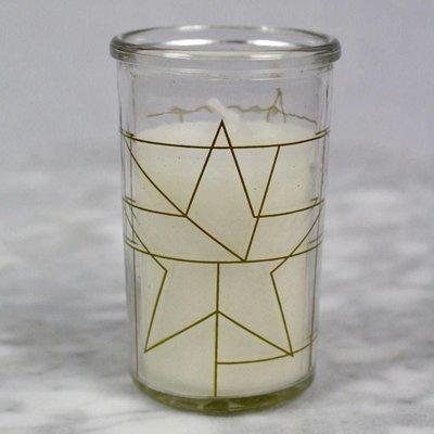 Gold kaars in glas met sterren