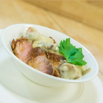 Varkensmédaillons in champignonroomaus 1000 gram vlees (3 tot 4 personen)
