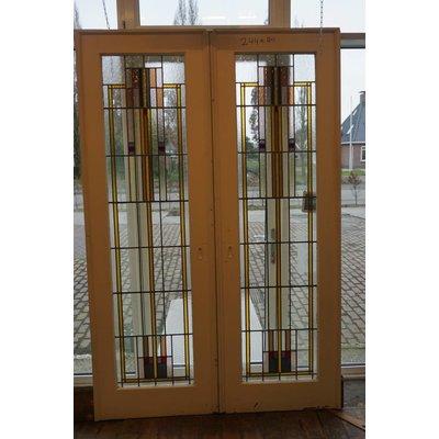Jaren 20 en suite deuren met glas in lood