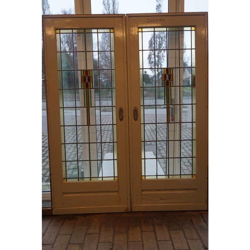 Ensuite deuren met glas in lood 1930