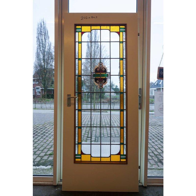 Glas in lood deur gebrandschilderd