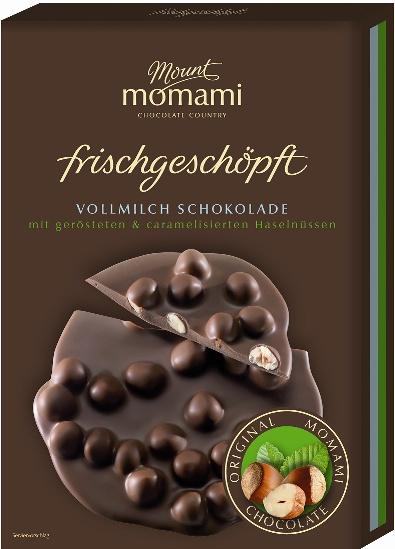 Frischgeschöpfte Vollmilch Schokolade - karamellisierte & geröstete Haselnüsse