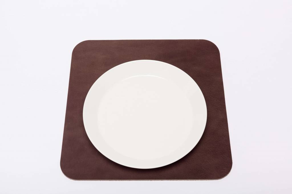Double Stitched Leather placemat square Polished concrete