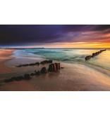 Dutch Wallcoverings Fotobehang Zonsondergang aan zee