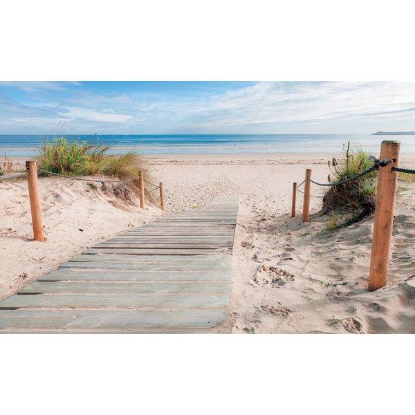 Fotobehang Strand met blauwe lucht