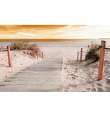 Dutch Wallcoverings Fotobehang Strand met gele lucht