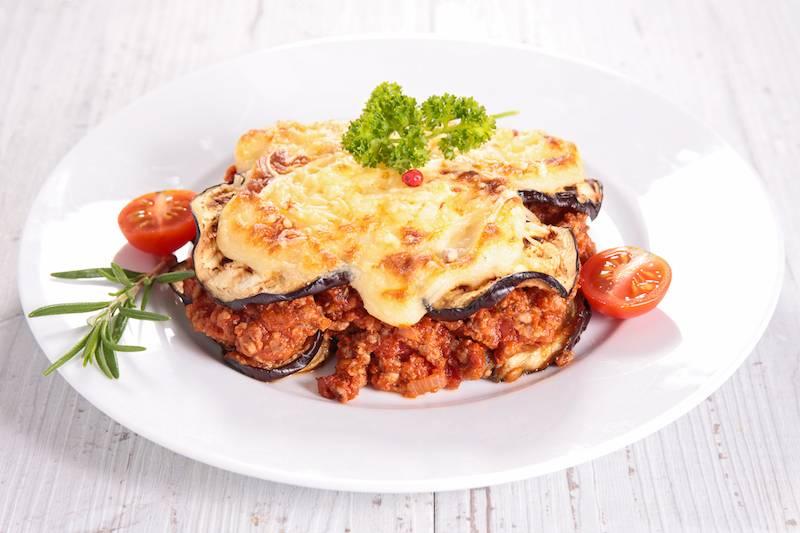 Lasagne pomodori met paddestoelen en gegratineerd met kaas