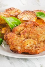 Schnitzel met champignonsaus, krieltjes en slasoorten en dressing