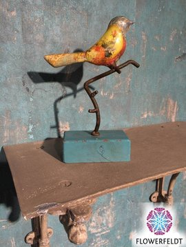 Metal bird on stand
