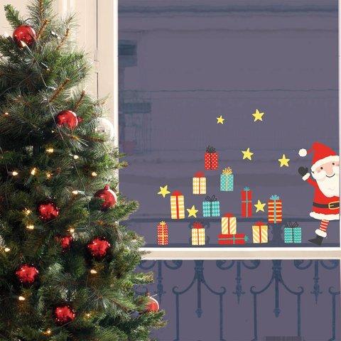Nouvelles Images raamstickers kerstman en cadeautjes