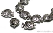 Tinnen vis kralen 14 stuks
