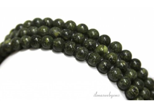 Serpentine beads around 6mm