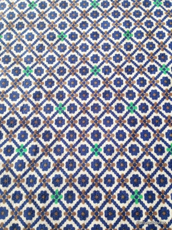 Viscosetricot blauw/bruin/groene bloemen